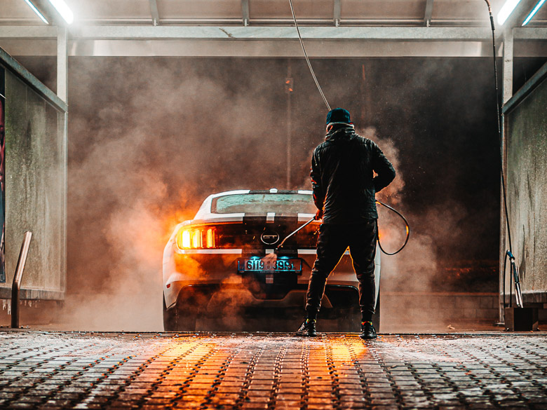 car-being-wash-by-man-3354647-3